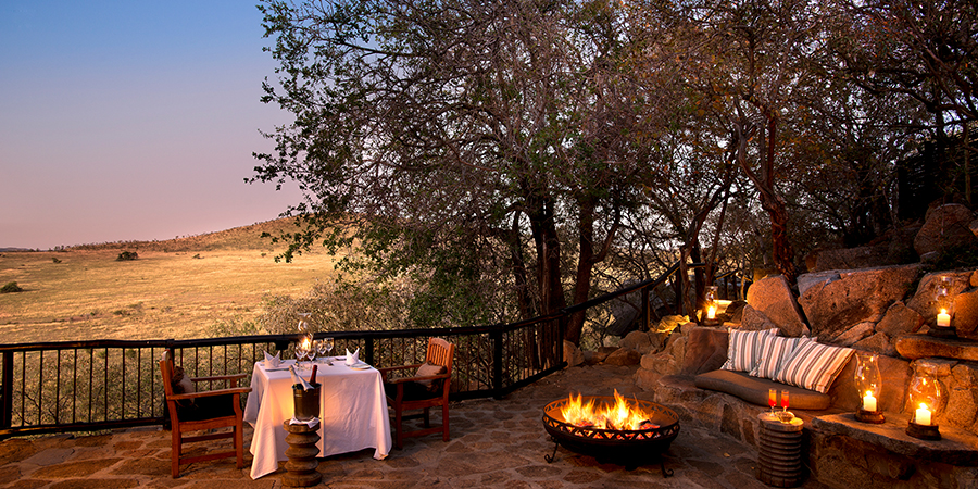 Private dinner alongside personal mini-boma fire at Tshukudu Bush Lodge